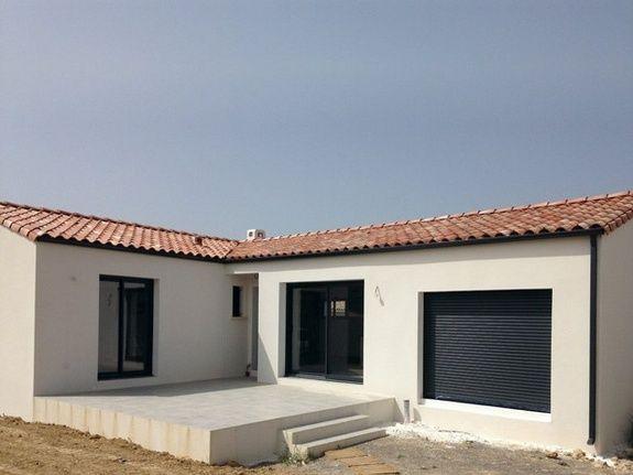 """Villa de forme en """"L"""" 100m² habitable; menuiseries alu gris anthracite"""